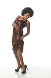 African-American female art model in an action pose wearing a dress