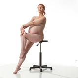 Art reference photos of nude pregnant woman seated and twisting