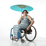 360 degree rotating art reference photos of a woman with spina bifida sitting in a wheelchair holding a parasol