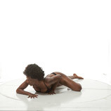 African-American female art model crawling on her stomach