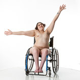360 degree views of a nude female art model with spina bifida posing in her wheelchair