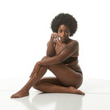 Art reference photo of an black female sitting