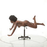 Nude African-American female in a flying pose for sculpture and painting reference