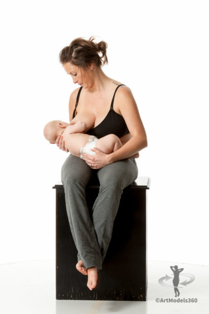 Artist reference photo of a woman breastfeeding her infant. Rotatable 360 degree view.