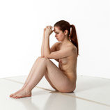 360 degree art reference photos of a nude female art model with natural pubic hair in a seated pose