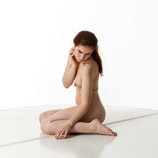 360 degree art reference photos of a nude female art model with natural pubic hair posing on the floor
