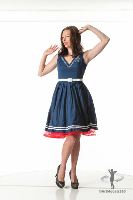 Fine art pinup model in a blue dress and a classic pin-up pose