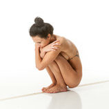 Nude 360 degree artistic reference photos of a slim dark haired female art model for use by figure artists and art students