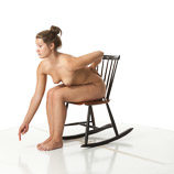 Nude 360 degree reference photos of a brunette female art model in poses for digital artists and sculpture students