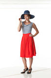 360 degree art reference photos of a young classic pin-up model in a red skirt and stripped shirt with a wide brimmed hat
