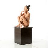Nude 360 degree art reference photos of a slim dark haired female art model for use by figure artists and art students