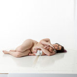360 degree nude art reference photos of a new mother nursing her infant in posed for painters and sculptors and art students