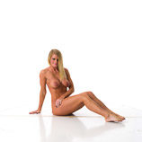 Nude 360 degree reference images of a tanned blonde female art model for use by figure artists and art students